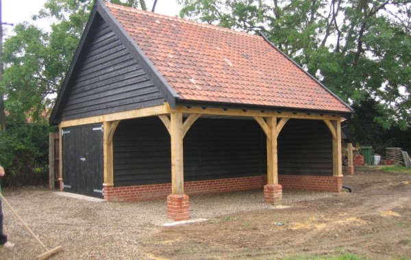 Two bay cartlodge with workshop